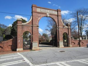 Red brick gate to Oakland Cemetery.